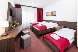 Posteľ alebo postele v izbe v ubytovaní Hotel Plus