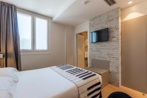 Cama o camas de una habitación en Casual del Jazz San Sebastián