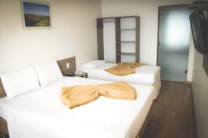 Cama ou camas em um quarto em Dalle Hotel