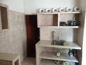 A kitchen or kitchenette at Casa machila