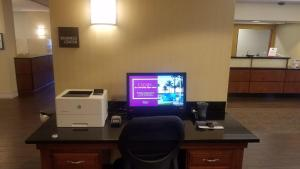 A television and/or entertainment center at Hampton Inn St. Louis-Airport