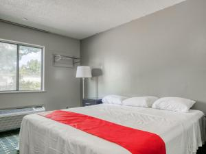 A bed or beds in a room at Raceway Inn