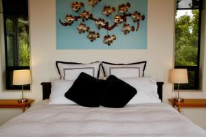 A bed or beds in a room at Te Huia