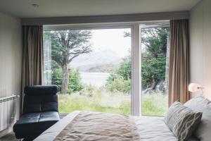 Cama o camas de una habitación en Hotel Lago Grey