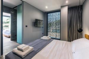 A bed or beds in a room at The Duke Boutique Suites