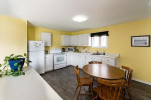 A kitchen or kitchenette at Out East B&B
