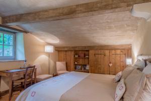 Un ou plusieurs lits dans un hébergement de l'établissement Domaine du Roc
