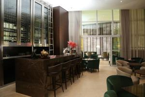 The lounge or bar area at Hotel Cadoro São Paulo