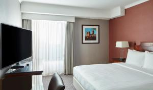 A bed or beds in a room at Durham Marriott Hotel Royal County