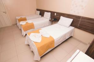 A bed or beds in a room at Hotel Casa Nova
