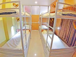 Двухъярусная кровать или двухъярусные кровати в номере Hotel Ganesha