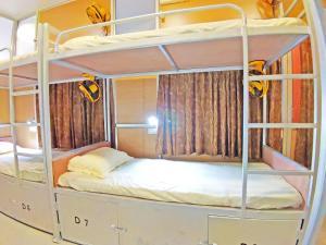 Кровать или кровати в номере Hotel Ganesha