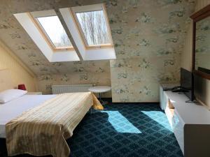 Кровать или кровати в номере Отель Ренессанс