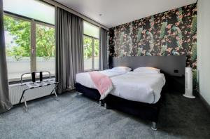 A bed or beds in a room at Hotel Sutor