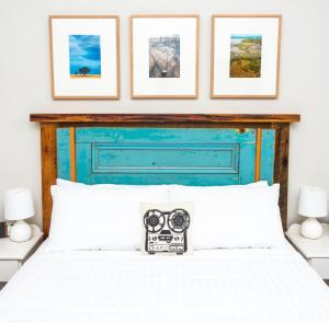 A bed or beds in a room at Stay Social