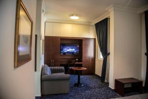A television and/or entertainment center at Bel Azur Hotel - Resort