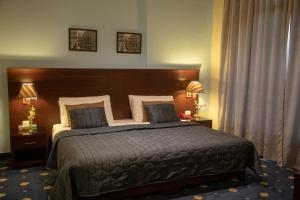 A bed or beds in a room at Bel Azur Hotel - Resort