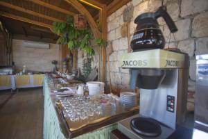A kitchen or kitchenette at Medusa Hotel