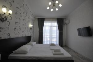 Кровать или кровати в номере Гостиница Тихая Гавань