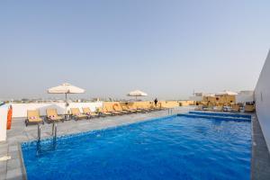 The swimming pool at or near Premier Inn Dubai International Airport