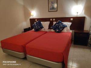 Uma cama ou camas num quarto em Hotel Alnacir