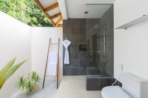 Ванная комната в Vilamendhoo Island Resort & Spa