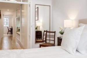 Letto o letti in una camera di Casa das Arcadas, com garagem - Praça de Giraldo