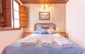 Cama o camas de una habitación en Casa Pepita