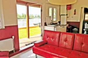 A seating area at Vinkeveen Chalet eiland