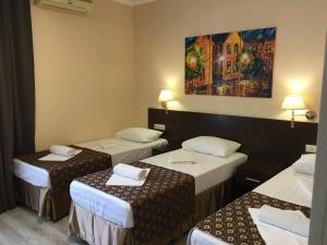 A bed or beds in a room at Guest house Eurasia