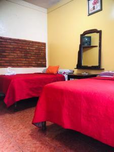 Кровать или кровати в номере Hotel Marjenny