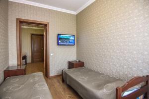 Кровать или кровати в номере Гостевой дом НИКОЛЬ