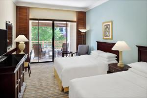 A bed or beds in a room at Dead Sea Marriott Resort & Spa