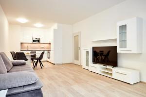 TV o dispositivi per l'intrattenimento presso Apartments Port Karolina