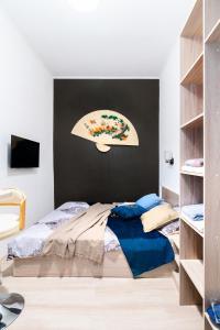 Кровать или кровати в номере Studio on Svetlanskaya 6