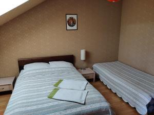 Posteľ alebo postele v izbe v ubytovaní Guest house Ošia