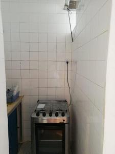 A kitchen or kitchenette at Living in the vibrant center of Salvador