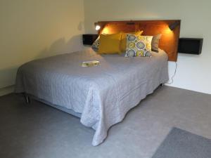 En eller flere senge i et værelse på Ferieidyl