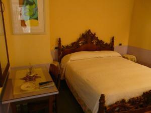 Letto o letti in una camera di Agriturismo La Riccardina