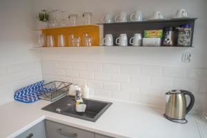 Kuchnia lub aneks kuchenny w obiekcie StudioApart2 Elbląg