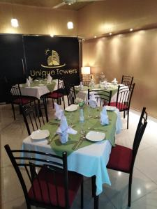 A restaurant or other place to eat at Unique Towers Luxury Boutique Suites