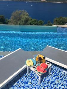 The swimming pool at or near Sappho Boutique Suites