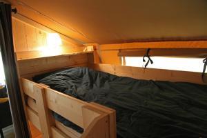 Ein Etagenbett oder Etagenbetten in einem Zimmer der Unterkunft Ferienhof BrinkOrt
