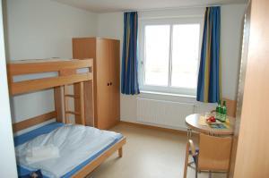A bunk bed or bunk beds in a room at Jugendherberge Glückstadt