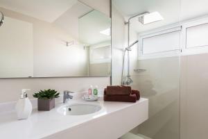 Een badkamer bij Playa Park Zensation