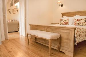 A bed or beds in a room at Casa Holstein Quinta de Sao Sebastiao Sintra