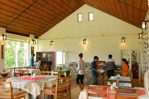 A restaurant or other place to eat at Kaivalyam Wellness Retreat