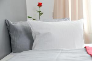 Ein Bett oder Betten in einem Zimmer der Unterkunft BEST WESTERN PLUS Aalener Römerhotel a.W.L.