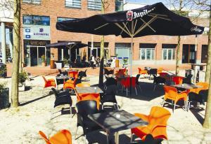 Een restaurant of ander eetgelegenheid bij City Hotel Restaurant Stadskanaal