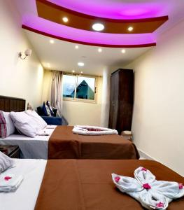 A bed or beds in a room at Horus Guest House Pyramids View